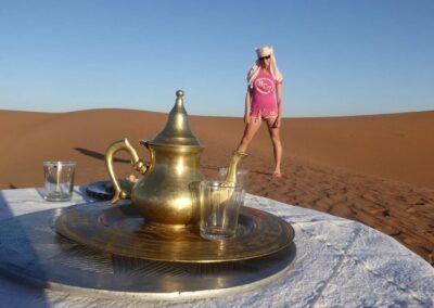 Rachelle Ginsberg And A Table Of Tea At Sahara Desert Morocco