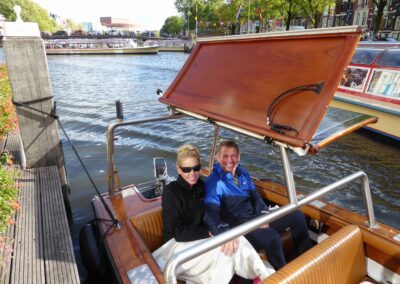 Rachelle Ginsberg Riding In A Boat In Amsterdam, Netherlands